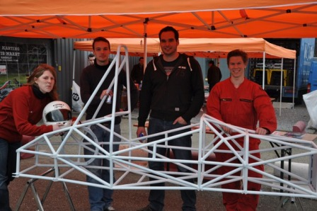 A VeroTech team showing the frame of the Formula car Areion.